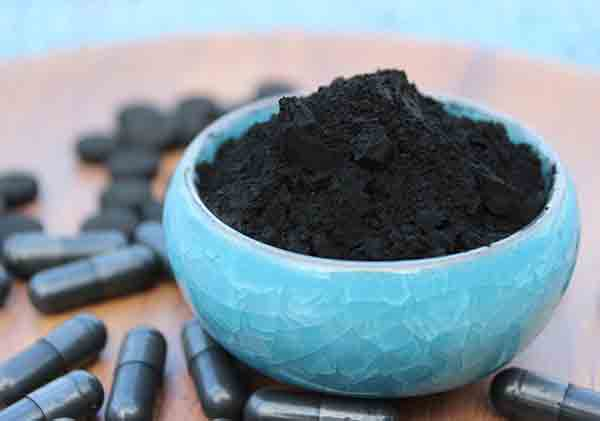 "What is Activated Charcoal? It's the New Black! Not all charcoal is created equal; It is not BBQ charcoal. Activated charcoal has become a bit of a buzzword for the past few years. It wasn't until a few years ago that it became a part of my essential travel apothecary. In powder or pill-form —activated charcoal has a plethora of uses. 3750 B.C, ancient Egypt used activated charcoal and it became the fuel to smelt ores because it burns hotter than wood. The Egyptians and Sumerians widely used it to produce bronze. At the time, Egyptians also discovered that charcoal was a great preservative. Along construction sites of the River Nile, it was found that burnt wood posts did not rot when buried in the wet soils. Egyptians slowly realized the anti-bacterial, anti-fungal properties of charcoal. This early discovery continued though the centuries to preserve wood. The Genesis of Activated Charcoal - Replica Egyptian Smelting Pot What makes the charcoal ACTIVATED? It's nearly pure carbon. It is wood pulp with very low ash content from sources such as coal, lignite (brown coal), and rye starch. It is then broken down into a fine granular form and later activated by treating it with steam, oxygen, carbon dioxide and other chemicals. When toxins get into your body through absorption, they can be eliminated with activated charcoal through the process of adsorption, when a chemical binds to another material. The many uses and benefits for activated charcoal 1. Water & Air Filtration Activated Charcoal can help filter air and water Wood tars from charcoal were used for caulking ships. It was apparent from the Phoenician trading ship wrecks from around 450 B.C. that drinking water was stored in charred wooden barrels. This method was used in the 18th Century on long sea voyages in order to have potable water. The wooden barrels were scorched to preserve the contents stored in them. Many water filters today use activated charcoal as a major component to help filter out contaminants and impurities. In air filters, activated charcoal adsorbs many types of allergens and pollutants, leaving the resulting air fresh and clean, especially for those who suffer from allergies, asthma, or other breathing problems. It can also be placed in free-flow containers to adsorb offensive or poisonous odours. ""It is only when ignited and quenched that charcoal itself acquires its characteristic powers, and only when it seems to have perished that it becomes endowed with greater virtue."" – Pliny, 50 A.D. 2. Activated Charcoal for Whitening Teeth and Oral Hygiene Care Activated Charcoal used for whitening teeth Some vices, such as coffee and wine can stain your teeth. Activated charcoal helps whiten teeth and it changes the pH balance in the mouth. Thus, reducing, cavities and gum disease. How to use it: wet a toothbrush and dip it in powdered activated charcoal. Brush teeth normally, swish mouth with water and rinse well. Do this a few times a week only, as it can be hard on enamel. Attention: activated charcoal is abrasive and can stain your caps, crowns and veneers. Do not use if you have thin enamel or sensitive teeth. 3. Activated Charcoal Face Mask—Uncover Clear Skin The multibillion cosmetic industry is robbing us blind with harmful chemical and perfumed-laden products. Look no further than your fridge and pantry! For beautiful clear skin, all you need is water, fresh produce and DIY (do-it-yourself) skin care. We would all be much healthier if we avoided processed food. Montreal's Best Kept Secret is Coop Coco. This is a good go-to store to buy and learn to make natural DIY skincare and cleaning products. Try this face mask once a week and let me know the results. Activated Charcoal Face Mask Activated Charcoal Face Mask Recipe • 1 Teaspoon of Clay (benonite, pink, red, white, green) • 1 Teaspoon of Activated Charcoal • 2 tsp of water • 1/2 tsp of Raw Honey • 2 drops of tea tree and lavender or Frankincense (or your favorite) 4. Gas Be Gone Activated charcoal is the perfect solution for the unbearable lightness of bloating Activated charcoal can reduce bloating and gas. It binds the gas-causing byproducts in foods that cause discomfort. This is noticeably helpful after eating beans. Dosing recommendations to alleviate gas and bloating: Take 500 milligrams one hour prior to a typical gas-producing meal, with a full glass of water. Follow with an additional glass of water immediately thereafter to help get the charcoal into your system, where it can bind with gas-producing elements. 5. Emergency Toxin Removal Remove Toxins with Activated Charcoal One of the most common activated charcoal uses is to remove toxins and chemicals in the event of ingestion. Activated charcoal is also used in the event of an overdose of many pharmaceutical drugs and over-the-counter medications. Activated charcoal is thousands of times its own weight in gases, heavy metals, poisons, and chemicals, often making them ineffective. Activated charcoal does not adsorb alcohol. It helps quickly remove other toxins from the body that contribute to poisoning. Alcohol is rarely consumed in its pure form; mixers that include artificial sweeteners and chemicals are common. Activated charcoal removes these toxins. 6. Treating Stomach Ulcers Tap into your gut brain and stop ulcers in their tracks with activated charcoal A peptic ulcer is an erosion in the lining of the stomach or duodenum (first part of the small intestine). Too much stress and an overproduction of acid in the stomach are often to blame. Activated charcoal is a natural and quick way to remedy stomach ulcers. It works by adsorbing excessive stomach acid. 7. Lowering Cholesterol Activated charcoal can lower cholesterol naturally Activated charcoal can lower the concentration of total lipids, cholesterol, and triglycerides in the blood serum, liver, heart and brain. This can be a natural option to lower cholesterol for those who are already on a healthy, low-cholesterol diet and want an alternative to prescription drugs. Tags: Activated Charcoal, Health, Teeth, Cholesterol, Stomach Ulcers, Toxic, Gas, Bloating, Skin, Facemask Keyword: Activated Charcoal Meta Description: Activated charcoal has several health benefits. It's great for health issues related to teeth, bloating, toxins, stomach ulcers, and skin. Here's a guide."